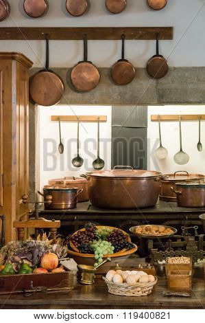 Old country style kitchen with copper pots