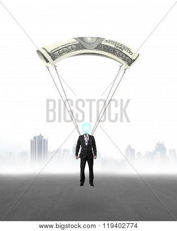 Businessman With Money Parachute