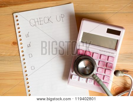 Health Checking Cost Concept , Top View Of Paper Check List Calculator And Stethoscope On Wood Table