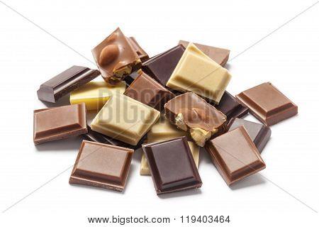 Various Chocolate Pieces On White