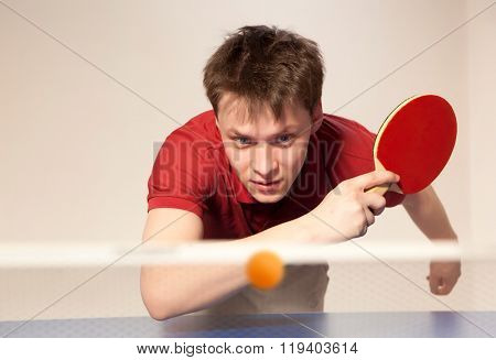 Young man playing ping pong
