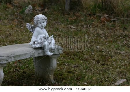 Cherub On Bench