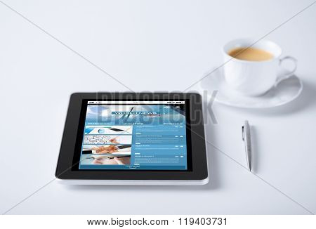 business, mass media, information and technology concept - tablet pc computer with world news web page on screen and cup of coffee