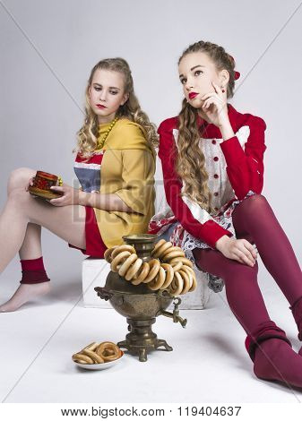 Portrait Of Two Young Beautiful Girls In The Russian Style