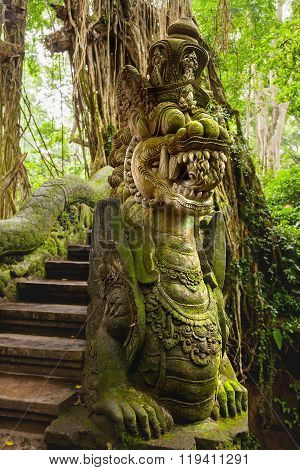 Statue Of Mythical Animal - Dragon With Wings And Decorations. Mossy Sculpture, Bali, Indonesia.