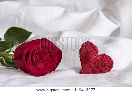 red rose with heart on white background,