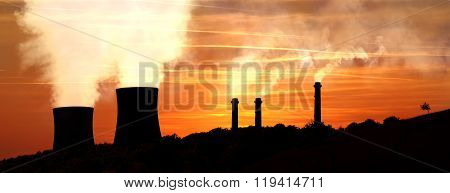 Power Generating Factories In The Mountains At Sunset Backlight