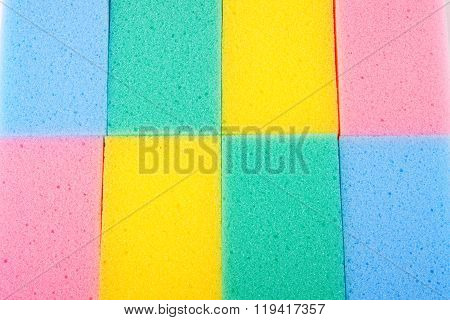 Background of colored kitchen sponges for washing dishes