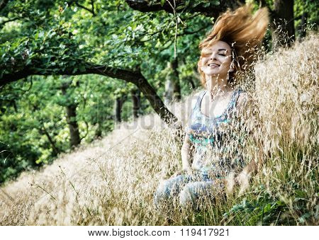 Beautiful Young Brunette Throws Hair In Nature