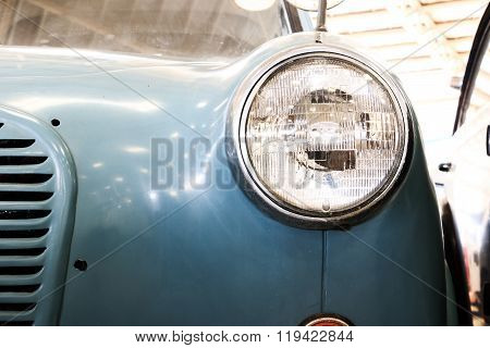 Close Up Of Headlight Lamp Vintage Classic Car. (vintage Effect Style)