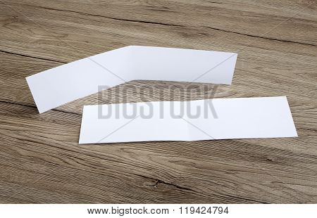 White Empty Card On Wooden Background To Replace Your Design.