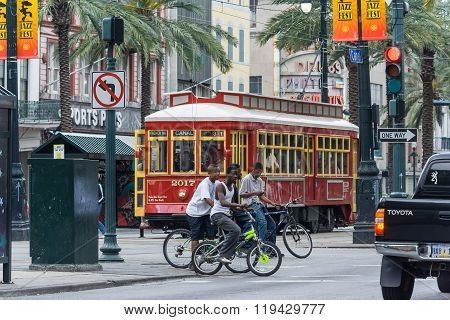 New Orleans, La/usa - Circa March 2009: African-american Kids Crossing Canal Street Riding Bicycles