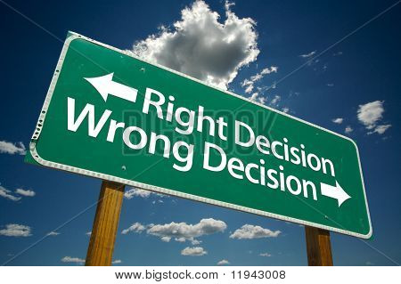 Right Decision, Wrong Decision Green Road Sign with Dramatic Blue Sky and Clouds.