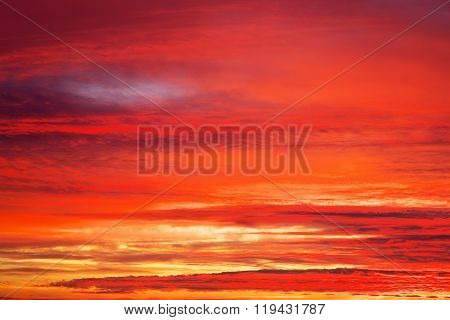 Fiery orange sunset sky. Apocalyptic sunset sky