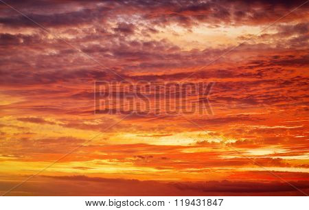 Fiery orange sunset sky. Beautiful apocalyptic sunset sky.