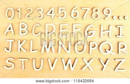 Wooden alphabet. Include numerals.