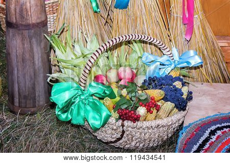 Fruits And Vegetables In Wicker Basket Sold At The Fair.