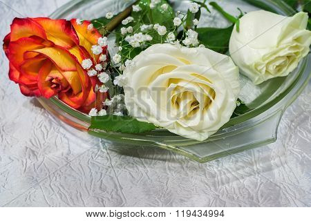 The Roses On The Table On A Glass Dish.