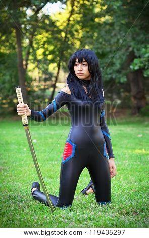 Young Girl Holding Samurai Sword. Original Cosplay Character
