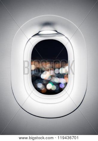Blur city light at airplane window