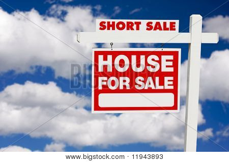 Short Sale House For Sale Real Estate Sign on Clouds.