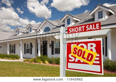 Sold Short Sale Home For Sale Real Estate Sign in Front of New House - Right Facing.