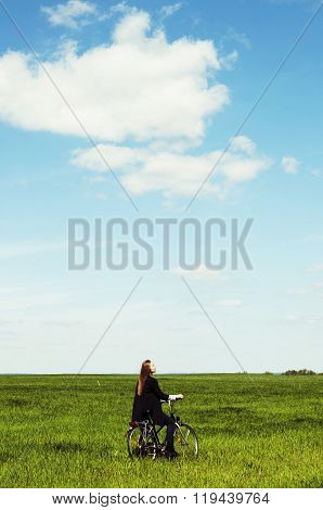 Happy Young Woman With A Vintage Bicycle On A Green Meadow. Youn