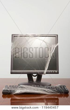 Computer covered in cobweb