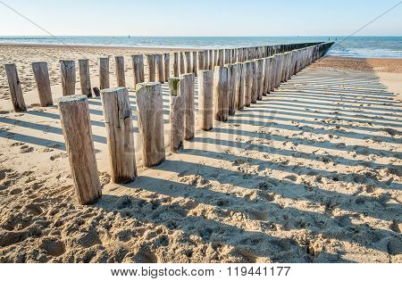 Traditional Wooden Breakwater On An Empty Dutch Beach