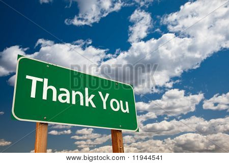Thank You Green Road Sign with Copy Room Over The Dramatic Clouds and Sky.