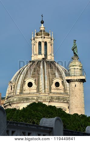 Trajan Column And Baroque Dome In The Center Of Rome