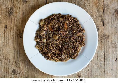 Green Lentils With Vegetables And Bacon, On Plate From Above.