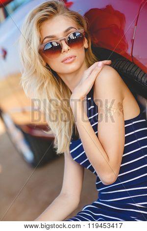 Beautiful young sexy woman near car outdoor.