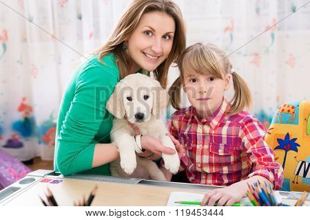 Happy mother, daughter and dog