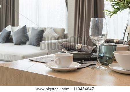 Table Set On Wooden Dinning Room With Cup Of Coffee