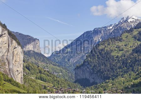 Swiss alpine village in a waterfall valley