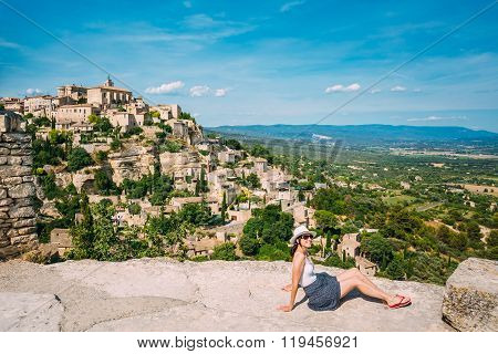 Young beautiful woman posing in a landscape of medieval hilltop