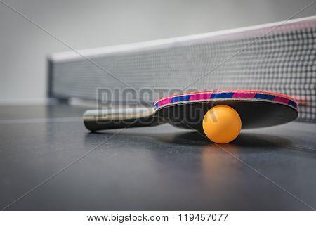 Table Tennis Racket With Orange Ball