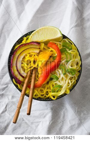 Thai noodles and curry in bowl