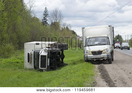 Inverted truck lies on the side of the highway. Leningrad region