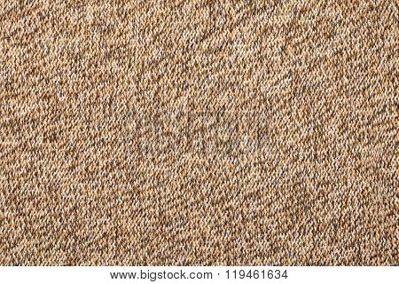 Brown knitted fabric made of heathered yarn textured background