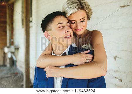 Bride embraces bridegroom
