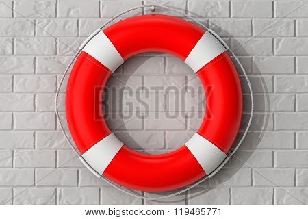 Life Buoy Hanging On The Brick Wall