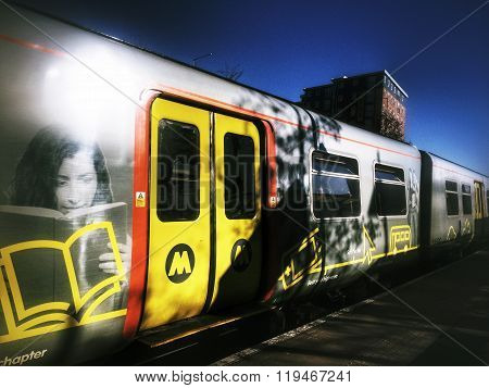 A Mersey Rail Train Stopped at a Station
