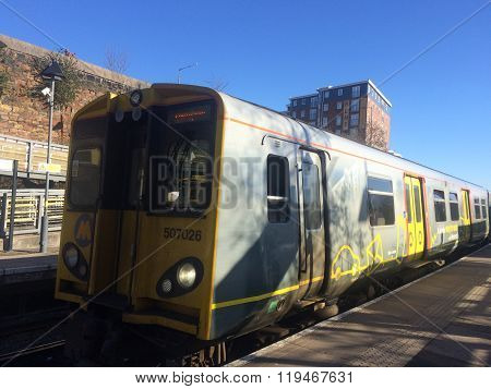 A Mersey Rail Train Pulls Up at a Station