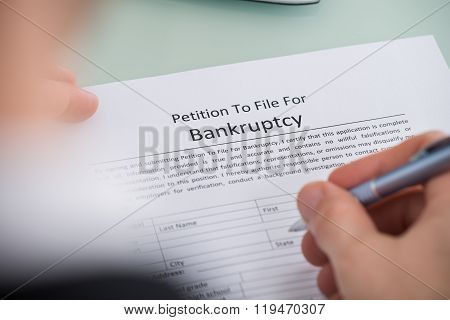 Person Hand Filling Form