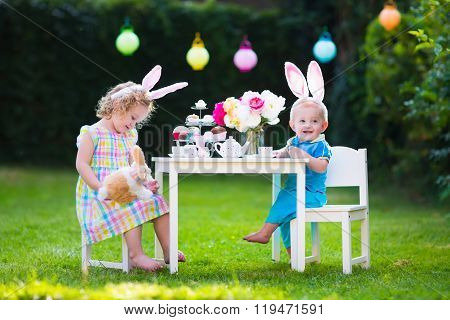 Kids Playing Easter Tea Party With Toys