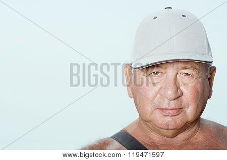 Senior man wearing a baseball cap
