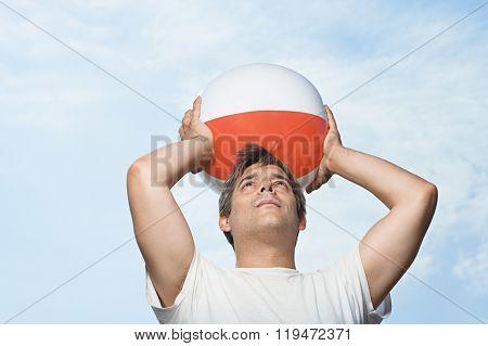 Man holding beachball