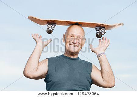 Senior man with a skateboard on his head